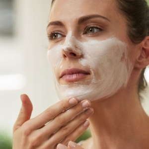 Model applies natural face mask